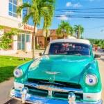 Green classic American car in Havana, Cuba — Stock Photo #73996509