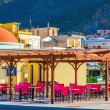Colorful restaurant with red chairs, Greece — Stock Photo #74344119