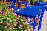 Blue tables in colorful Greek restaurant — Stock Photo