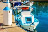 Small boat painted in blue and white — Stock Photo