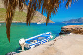 Blue and white wooden boat in cosy Greek port — Stock Photo