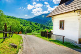 Wooden white hut in village, Eastern Europe — Stock Photo