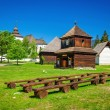 Rare wooden bell tower with folk houses Slovakia — Stock Photo #77580760