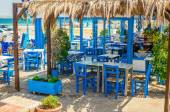Romantic Greek restaurant with blue chairs, Greece — Stock Photo
