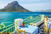 Typical Greek restaurant on teracce with sea — Stock Photo