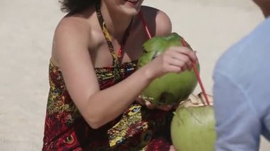 Happy couple on the beach with coconut — Stock Video