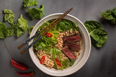 A bowl of Chinese ramen noodles with beef, Chinese cabbage, chil — Stock Photo