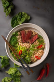 A bowl of Chinese ramen noodles with beef, Chinese cabbage, chil — Stockfoto