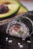 Maki sushi rolls with salmon and avocado on the vintage japanese — Foto de Stock