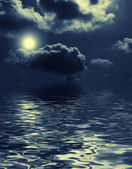 Nightly clouds over the water — Stock Photo