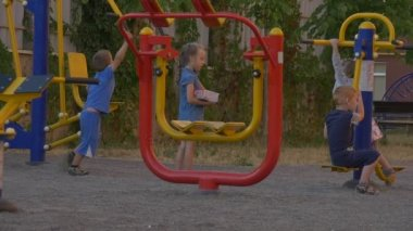 Kids play on the playground in the yard — Stock Video