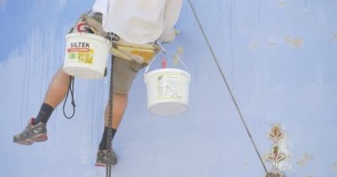 Man's Legs, Restorer is Holding on a Rope, Putting Down The Brush Into Paint, Paints in a Buckets, Man is Painting the St. Michael's Cathedral — Stock Video