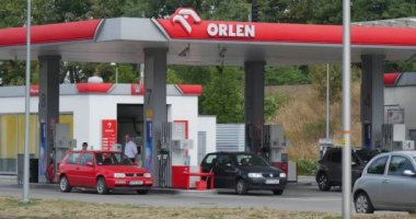 People are Standing at the Car on Filling Station Gas Station Orlen Red Black And Grey Cars Stand At The Filling Station Light Grey Car Parked Near — Stock Video