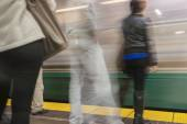 Train station and commuters in motion blur. — Stock Photo