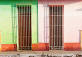 Barred doors and broken pavement in third world town. — Stock Photo