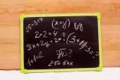 School example, written on a blackboard background — Stock Photo