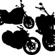 Black silhouettes of a motorcycles — Stock Vector #73030979