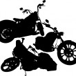 Black silhouettes of a motorcycles — Stock Vector #73031041