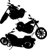 Black silhouettes of a motorcycles — Stock Vector