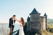 Walk just married on the background of the old castle — Stock Photo