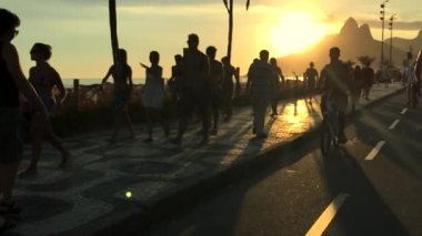 Surfer Rides Bike Ipanema Sunset Slow Motion — Stock Video