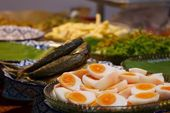 Boiled eggs and fried mackerels — Stock Photo
