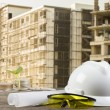 Business Growing  file of safety helmet and architect plant on wood table with  construction — Stock Photo #77492620