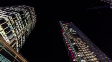 Time lapse of Heron Tower and 99 Bishopsgate at night. — Stock Video