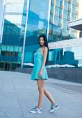 Summer moment. Woman portrait outdoor. sunny warm weather day. Woman in dress walking in the city street — Stock Photo