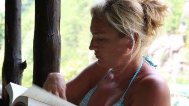 Blonde women reading a book — Vídeo de Stock