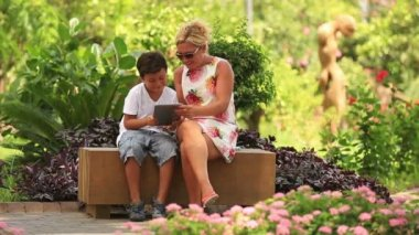 Mother and son using digital tablet — Video Stock