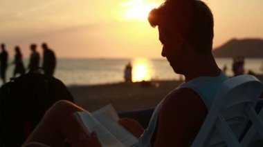 Attractive young man reading a book — Stock Video