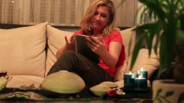 Blonde women using digital tablet — Wideo stockowe