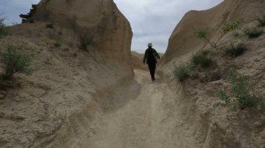 Adult male walking through Cappadocia — Stock Video
