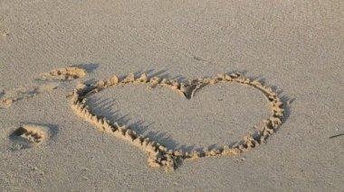Heart shape on a beach — Stock Video