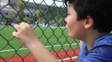 Child watching football match 2 — Stock Video