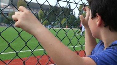 Child watching football match — Stock Video