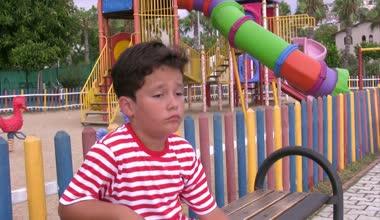 Sad child in the playground — Stock Video