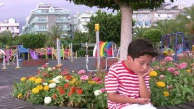 Sad child at playground — Stock Video