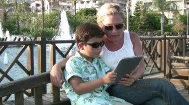 Mother and son using digital tablet — Stock Video