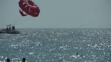 Banana boat and parasailing — Stock Video