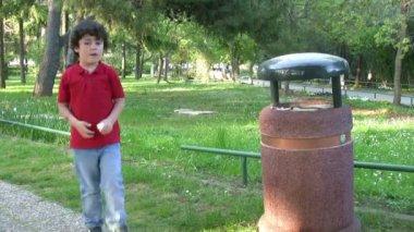 Little boy Picking Up Litter — Stock Video