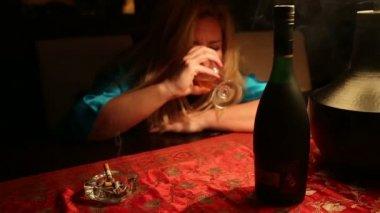 Alcoholic woman drinking wine — Stock Video