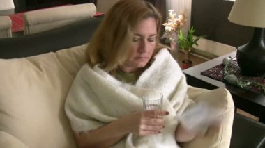 Sick woman taking her pills — Stock Video