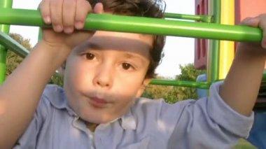 Little boy climbing bars at park — Stock Video