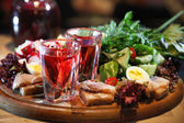 Cranberry Vodka with vegetables — Stock Photo