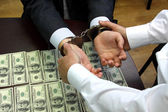 Bribe. American dollars. arrested for bribery. caught red-handed — Stock Photo