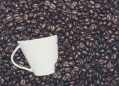 Cup in the coffee beans — Stock Photo