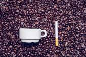 Coffee cup, cigarette and coffee beans — Stock Photo