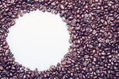 Coffee beans texture with a white circle for text — Stock Photo